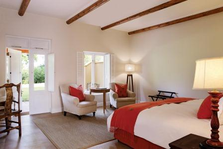 This Signature Room has views of the surrounding gardens.