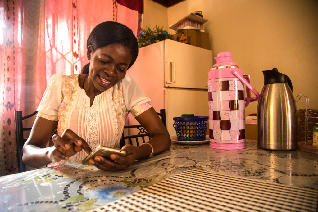 A Kiteka female entrepreneur is given essential smartphone skills to improve her business operations.
